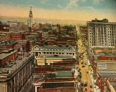 Looking west along Baltimore Street towards the southwest, from perhaps the Tower Building. You can see the Sun Building in the center of the photo and in the background, the Bromo Seltzer Tower, with the giant bottle of Bromo of top of it.