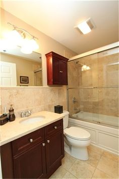Light colored tile with cherry wood