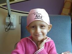 "Another inspiring little Cancer Warrior showing her positive spirit with her beautiful smile, and displaying her fighting spirit by wearing her ""Cancer Fears Me"" cap.  (coolkidscampaign.org)"