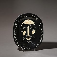PICASSO/ ceramic plate,bearded face white on black 32 x 39 cm
