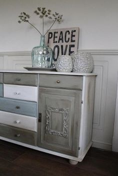 Old pine cupboard pimped with chalk paint, picture frames and different buttons