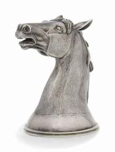 A SMALL RUSSIAN SILVER STIRRUP CUP MODELLED AS A HORSE'S HEAD -   MARK OF SAMUEL ARND, ST. PETERSBURG, 1856, ALSO BEARING A LATER FRENCH CONTROL MARK -   Gilt interior,  3 in. high (7.5 cm.)  5 oz. (155 gm.)