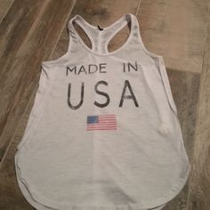 """""""Made In USA"""" Tillys top Tillys """"Made In USA"""" top, worn once. The tag was itchy so i cut it off, Size Small. Great condition Tilly's Tops Tank Tops"""