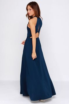 elegant foundation for this chic gown, topped with a rounded halter-style neck and darted bodice, for a bit of structure above the maxi-length skirt with twin thigh-high slits. A triangular back cutout rests below a keyhole cutout.