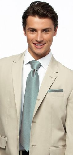 Love the khaki suit but with a pink tie!