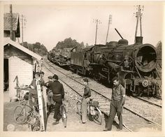 French Resistance Fighters guard German supply train that has been destroyed by US armored forces, Aug 1944.