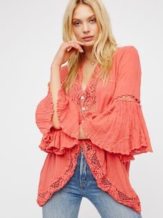 Annabelle Jacket | This easy, breezy and one-of-a-kind jacket features femme flared sleeves, pretty crochet accents and beachy shell button closures. Crinkly, semi-sheer fabrication.