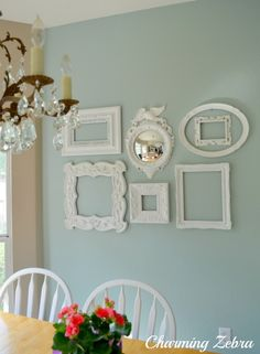 I think I might make a little collection of  white vintage-styled frames/mirrors to use as wall art.