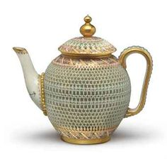 A ROYAL WORCESTER (GEORGE OWEN) 'JEWELED' AND RETICULATED TEAPOT AND COVER  -  DATE CYPHER FOR 1883, GREEN PRINTED AND IMPRESSED CROWNED MONOGRAM MARKS, IMPRESSED U5, PUCE PAINTED RSI