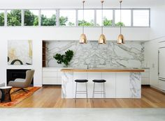Stunning use of marble though we prob don't have the right space for this. Light fixtures are nice too. Like the combo of marble, white with a touch of natural wood.