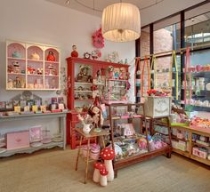 Light and feminine display of gift ideas. I want the polka dot tea kettle on the top shelf~