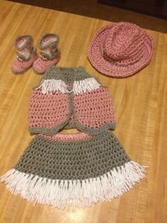This adorable cowgirl outfit includes the Hat, Skirt , Vest and Booties.  It can be made from NB - 12mos. Can make in any color combination! Also can do the Boy Chaps in place of the Skirt