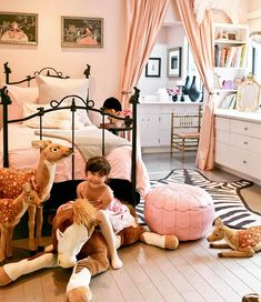 black bed pink sheets zebra rug white dresser, little girls room  Bedroom Decorating Ideas: Young Children - Traditional Home®