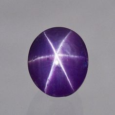 Grape Asterism, 6.32 carats, 9.42 x 8.02 x 7.52 mm (Photo Mia Dixon)  Purple star sapphire from Sri Lanka.  exceptionally fine star with sharp, full rays centered perfectly over the stone.  The unique property is the grape-juice purple color that give the gem a candy-like feel.