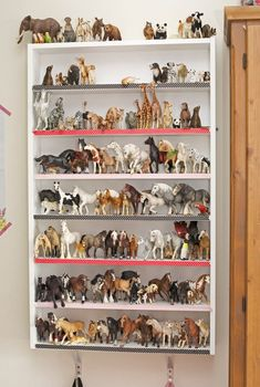 We love this storage solution for our Schleich and Safari animal figures. get something like this.: