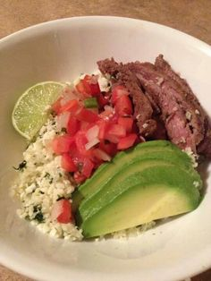 Paleo Burrito Bowl with Chipotle-style cauliflower rice from Popular Paleo. Get in my belly! http://popularpaleo.com/2013/01/07/cilantro-lime-cauliflower-rice/