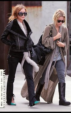 MK's in heels, but Ashley's got flat boots. I like her sweater coat.
