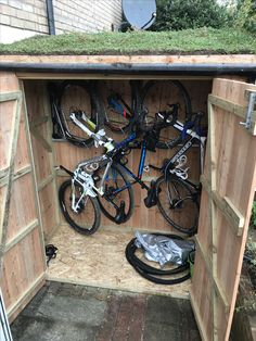 Foldable hooks make the Vertical shed shallow plan, and a little wider too. in 2020 Bicycle Storage Shed, Outdoor Bike Storage, Bike Shed, Shed Storage, 12x8 Shed, Bike Storage Solutions, Timber Garage, Barn Style Shed, Vertical Bike