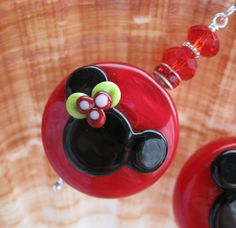 Holiday Holly Mickey Mouse Earrings Lampwork Glass Beads Sterling Silver Christmas Jewelry Minnie Mickey Earrings Disney Earrings. $40.00, via Etsy.
