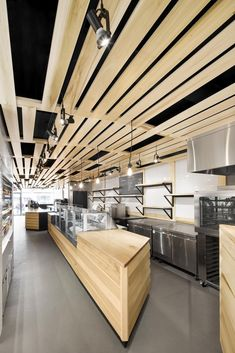 Au Pain Doré is a minimalist interior located in Montreal, Canada, designed by Naturehumaine, as a bakery that's located on the ground floor of a three-story building on Côte-des-Neiges Bakery Design, Cafe Design, Restaurant Design, Interior Minimalista, Monochrome Interior, Minimalist Interior, Modern Minimalist, Space Interiors, Office Interiors