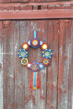 2015 Honorable Mention - Depicted is Sarah Marcyan's creative way to utilize the rosettes which she had accumulated from over 12 years of riding and competing within many disciplines on multiple horses.