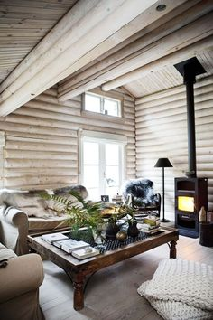 """Some think that whitewashing a log home interior somehow """"updates"""" the natural l. - Some think that whitewashing a log home interior somehow """"updates"""" the natural look of wood. Log Cabin Living, Log Cabin Homes, Log Cabin Bedrooms, Cozy Living, Log Home Interiors, Country Interiors, Design Interiors, Modern Interiors, Cabin Chic"""