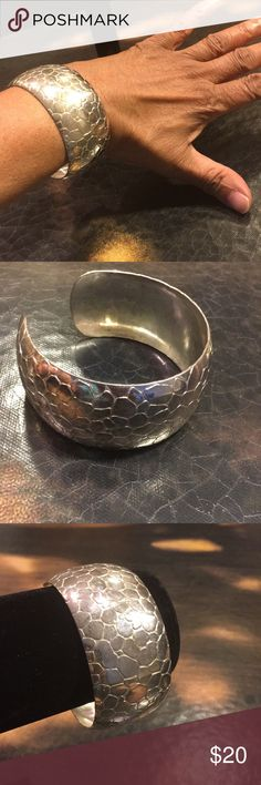 Beautiful Silvertone Carved Cuff Bracelet So dazzling and shiny it was hard not to film my reflection.  Carved animal print cuff bangle bracelet that would be the perfect wow accessory to dress up or down ANY outfit.  EUC. Jewelry Bracelets