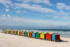 These colorful little structures on Camps Bay Beach, Cape Town, South Africa are too cute!