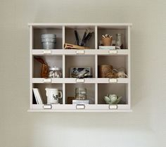 Really useful storage shelves with a vintage twist. Nine good-sized cubby sections, each with a card holder (in brass or chrome).Can be used freestanding or wall hungmade from MDFsize: 70cm wide x 20cm deep x 61cm highadjustible shelvesavailable painted in any of our standard paint colours with an optional antique finish (see options below)fitted with chrome or brass card holdersThe key holder measures 27cm x 40cm x 1cm deepit is made from MDF and is fitted with 6 br...