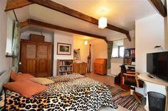 Fun Bedroom in Cornish barn conversion - beams, dual aspect, sloping ceiling