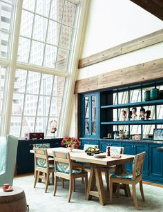 large windows in a loft kitchen - cool colors too
