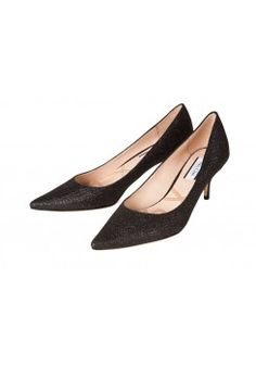 Effortlessly elegant, the Ruby heels are a wardrobe essential to instantly add polish to any ensemble. Cut in a classic kitten silhouette, they are given a modern touch with a hint of black glitter. http://www.fashionet.com.au/lucy-choi/ruby-black-glitter?limit=36