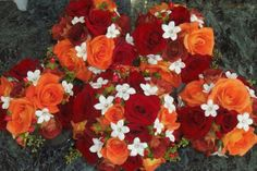 Red, orange and rust color, fall bridal bouquet and bridesmaids bouquets
