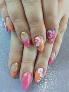 Orange and pink gel polish with one stroke flower nail art
