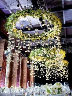 Wedding Reception Decor ~ Hanging Lights ~ Flowers you could do this with hula hoops above the tables hanging down from the tent wrap them in fabric or burlap with lights coming down