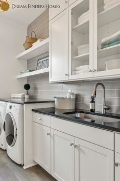 This organized laundry room in our Montauk ll model in Beachwalk should be in every home! Grey Backsplash, Utility Sink, Laundry Room Organization, New Home Construction, Beach Walk, Floating Shelves, Building A House, New Homes, Kitchen Cabinets