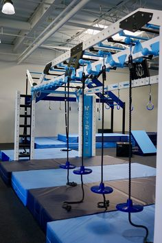 Ring toss and balance disc training features on the MoveStrong Nova XL functional fitness gym rig for calisthenics and ninja warrior style workouts