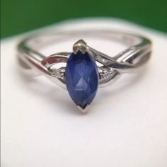 Real tanzanite & dimond ring Beautiful intense Blue color genuine Tanzanite stone in marquise shape (about 0.6 ct) centered on solid white gold 10K.  Two round real diamonds on each side. they are about 0.02 ct each. Stamped 10K. the ring is about size 7 and sizable. Real gold Jewelry Rings