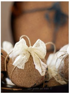100 Days of Christmas – Day 38 - Give your tree a brand new look by wrapping your bulbs in burlap and lace. This idea comes from Cat on a Roof.