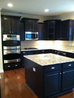 Kitchen Espresso Cabinets Light Grainet Stainless Steal Double Oven And Antique Hardwood