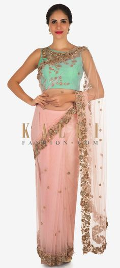 Buy Online from the link below. We ship worldwide Click Anywhere to Tag Pink and mint blue saree in net featuring the zardosi and 3D flower embroidery work only on Kalki   This saree in pink will take care of all your wedding functions with its classy and stunning look that it delivers. The saree is featured in net fabric. It is anatomically designed using the zardosi embroidered borders with 3D flowers that highlights the saree to the core.