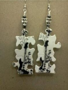 Zentangle puzzle earrings...cool..except teh freaky faces :)