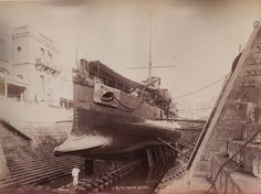 HMS Polyphemus in a Malta Dockyard, 1881. As the only torpedo ram to serve in the Royal Navy, she was designed to penetrate harbours at speed, sinking ships at anchor. The central torpedo  tube was fit with a steel bow cap which hinged upward - reinforced to be a ram. Interesting hydrodynamic effects were observed, being quite by accident one of the first bulbous bows. The ship found a place in the H. G. Wells' novel The War of the Worlds.