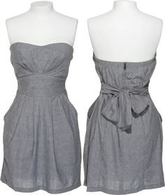 """Trixxi strapless dress is constructed of a woven chambray fabrication. The front bodice and skirt pleat along the waistband. A wide sash belt inset at the side seams tie in back. The skirt is finished with a folded hem. This style has an adorable, classic silhouette has pockets at the side seam. Secures with a zipper in back. Measures approximately 28"""" from the neckline to the hem."""
