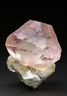 A stunning gemmy pink to rare colourless in some orientations single crystal Fluorite on Muscovite from Nagar area Pakistan. Crystal Classics Minerals