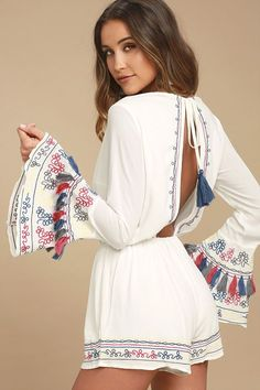 There's nothing but island living ahead with the Island of Capri White Embroidered Long Sleeve Romper! Gauzy woven rayon shapes a V-neck and tying, open back above and an elasticized, drawstring waist. Red, blue, grey, and yellow embroidery decorates the bodice, long bell sleeves (with tassels!), and relaxed shorts.