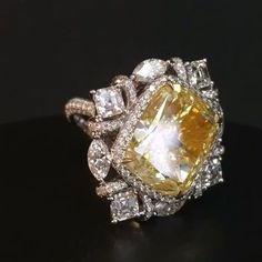 over 10 carat yellow diamond and white diamond ring