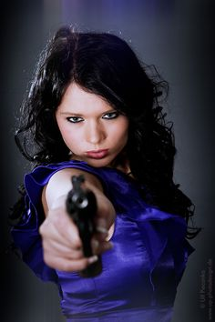 Model with gun taken 2012 in my photostudio - she was pretty cool  ... and hot ;-) http://www.up-fotodesign.de