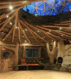 cob house spiral wood ceiling with large dome skylight, reciprocal roof, natural building