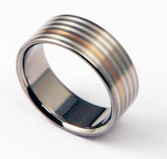 """Titanium Ring with Silver and Rose Gold inlays """"The Pizzicato"""""""